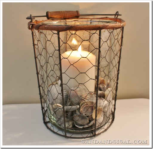 Wire Fish Basket with shells and candle