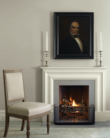 Above the bedroom's fireplace hangs a painting of Daniel Webster, a Massachusetts senator in the mid-1800s and an ancestor of Eric's.