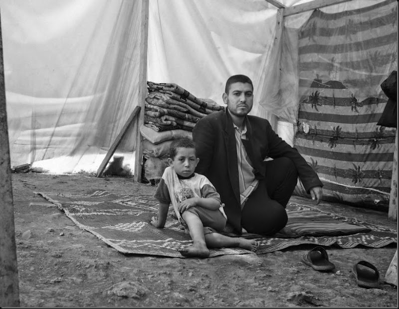 A father and son inside their tent in the Bekaa Valley after they fled from the Syria. (Moises Saman/Magnum Photos for Save the Children)