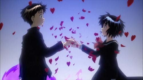 Tsubaki and Urabe the two lead characters clasp hands opposite another as red petals burst forth around them