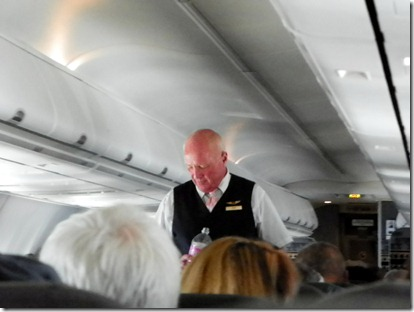 Inside Alaska Airline, I was surprised.  Not the pilot, but a steward.  And for a moment, I thought Bruce Hoover was on this flight!!