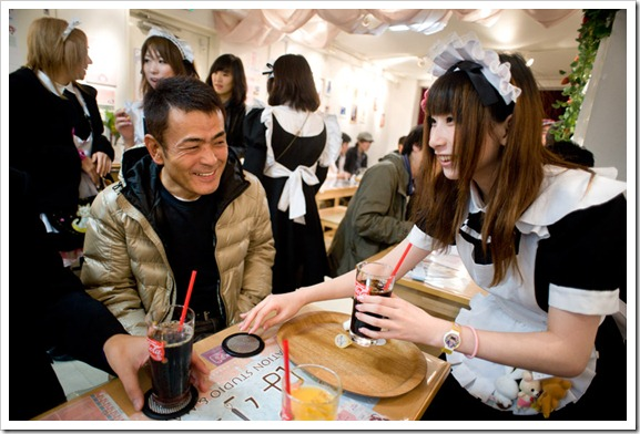A 'maid cafe' in Akihabara, Tokyo. A staple of Japanese popular culture, the cafes offer a distinctive atmosphere, where subservient maids in Victorian outfits role-play to please customers, who are treated and greeted as 'Masters.'