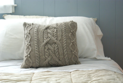 I love the warm, homey look of knit pillows. [via preciousknits on Etsy]