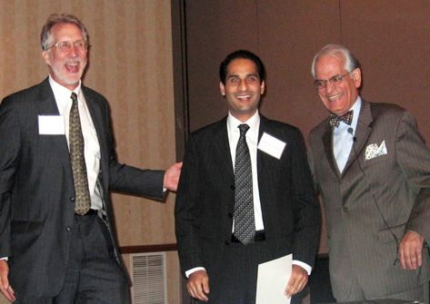 Shais Jallu accepts the award for second prize in research at the 2010 Research Symposium