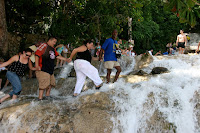 Tourists being dragged up the falls