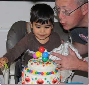 david and Dad blowing candles