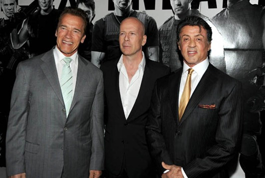 """Premiere Of Lionsgate Films' """"The Expendables"""" - Arrivals...HOLLYWOOD - AUGUST 03:  California Governor Arnold Schwarzenegger, actor Bruce Willis and director/writer/actor Sylvester Stallone arrive at the premiere of Lionsgate Films' """"The Expendables"""" at Grauman's Chinese Theatre on August 3, 2010 in Hollywood, California.  (Photo by Kevin Winter/Getty Images)"""