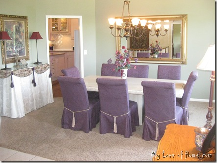 Marble Table, green walls, dining room, purple chairs, large mirror