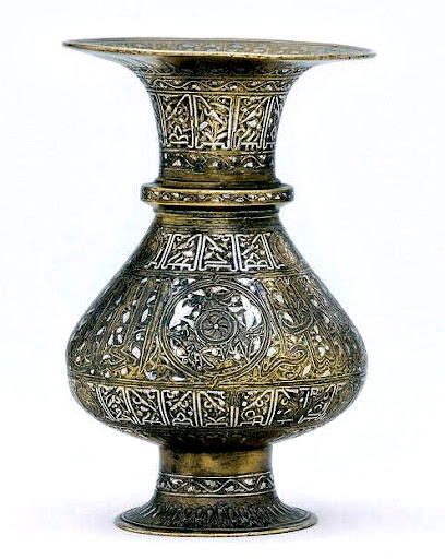 A Mamluk Silver Inlaid Brass Vase. Egypt. 7th century AH / 13-14th century AD