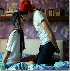 Kissing-young-couple-cute-love-on-bed-romantic