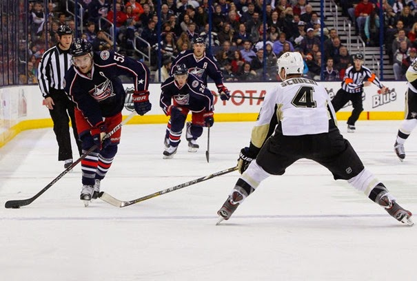 Dec 29, 2013; Columbus, OH, USA; Columbus Blue Jackets center Mark Letestu (55) passes the puck as Pittsburgh Penguins defenseman Rob Scuderi (4) during the second period at Nationwide Arena. Mandatory Credit: Russell LaBounty-USA TODAY Sports