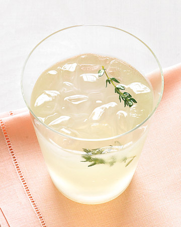 Fresh herbs, like thyme, impart an aromatic layer to a spiked lemonade.