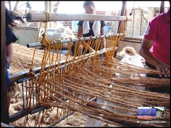 Weaving nets in coco fiber loom