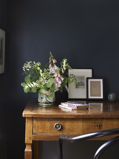The pastels in this arrangement look great in against the dark blue wall.