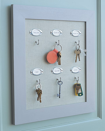 Rather than clutter a single hook with several sets of keys, make a custom board that gives each set its own clearly labeled space. To make the board, have a piece of Homasote fiberboard cut to fit into a picture frame. Cover board with a piece of linen, and staple it at back. Tuck the board into the frame, then nail on labels and attach one screw hook for each set of keys.