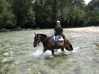 Fording the river on horseback