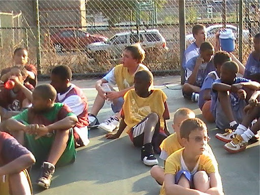 Boys on a playground taking a break from a basketball clinic in Pittsburgh's Hill District.