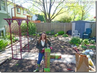 Shawna in back yard with kits ready to be assembled.