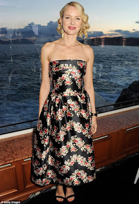 Blonde woman in floral dress with finger waves at Cannes