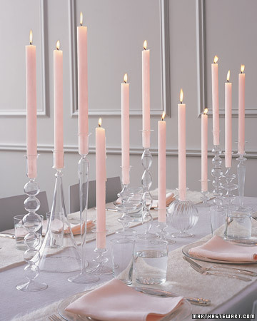 In lieu of floral arrangements, display sleek tapers in a variety of shapely glass candlesticks. Mix them in varying heights and designs to create a sophisticated, chic setting. (marthastewartweddings.com)