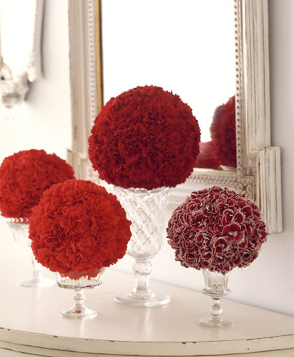 Carnations are one of my favorite flower, I love the different red shades of carnations in this photograph -- these arrangements make a simple but stunning centerpiece.