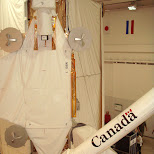 the canada arm with the dutch and japanese flag in the backgroound in Cape Canaveral, Florida, United States