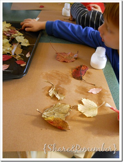 gluing fall leaves on paper