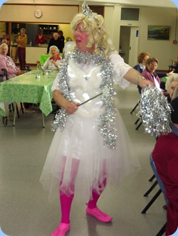 Fiona, the fairy, using her magic wand and silvery shaker to conjure up some Christmas cheer