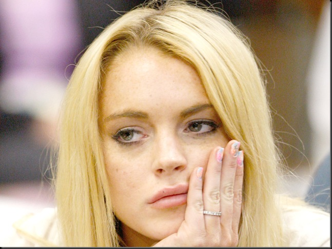 LOS ANGELES, CA - JULY 06:  Actress Lindsay Lohan attends her probation revocation hearing at the Beverly Hills Courthouse on July 6, 2010 in Los Angeles, California. Lindsay Lohan was found in violation of her probation for the August 2007 no-contest plea to drug and alcohol charges stemming from two separate traffic accidents, she is scheduled to surrender on July 20, 2010 to serve her 90 day jail sentence.  (Photo by David McNew/Getty Images) *** Local Caption *** Lindsay Lohan