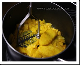 Cook till mangoes are tender and mash them using a masher