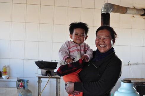 our host and cook with her baby