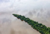 Para, Brazil. February 11, 2012. Peninsula of rainforest in the Tapajas River south of Santarem Brazil. Photo by Daniel Beltra for Greenpeace