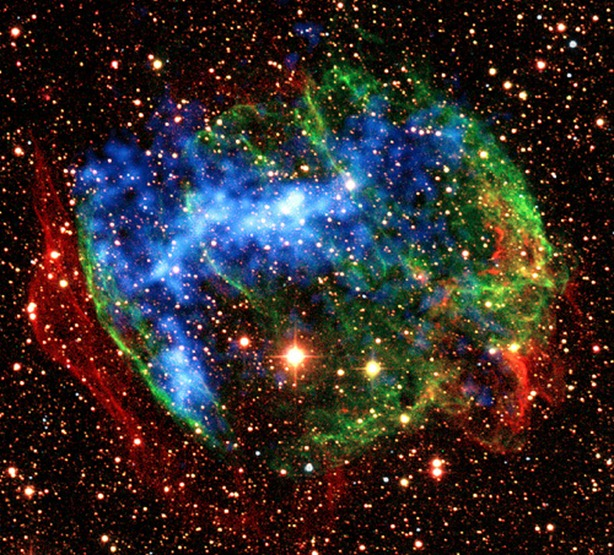"Release date Dec. 30, 2009  In the supernova remnant W49B, Suzaku found another fossil fireball. It detected X-rays produced when heavily ionized iron atoms recapture an electron. This view combines infrared images from the ground (red, green) with X-ray data from NASA's Chandra X-Ray Observatory (blue). Credit: Caltech/SSC/J. Rho and T. Jarrett and NASA/CXC/SSC/J. Keohane et al.  To learn more about this image go to:  http://www.nasa.gov/mission_pages/astro-e2/news/fossil-fireballs.html  <b><a href=""http://www.nasa.gov/centers/goddard/home/index.html"" rel=""nofollow"">NASA Goddard Space Flight Center</a></b>  is home to the nation's largest organization of combined scientists, engineers and technologists that build spacecraft, instruments and new technology to study the Earth, the sun, our solar system, and the universe."