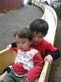 Kai and Eidan on the long slide at Robot Park