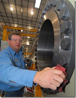 Mark Perrin, a drive train speciialist at Nordex, tightens bolts on a 24-ton wind turbine gearbox. Perrin is a son of Jonesboro Mayor Harold Perrin.