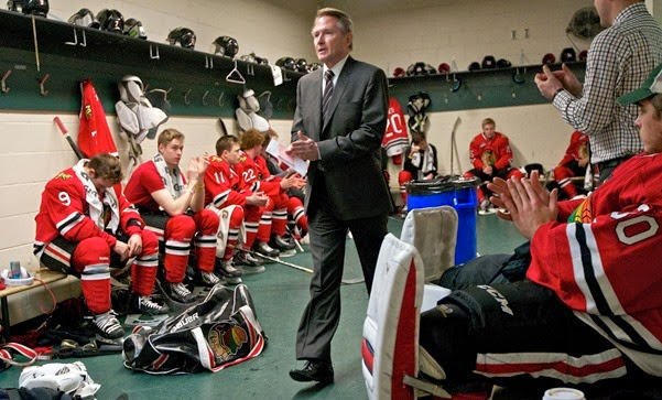Head Coach Mike Johnston finishes a pregame talk before his team takes the ice against Everett on Sunday January 26, 2014. (Zachary Kaufman/The Columbian)