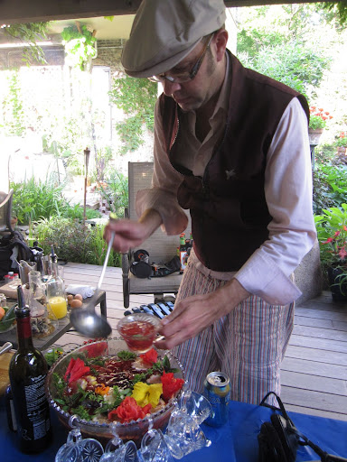 Mixologist Adam Seger prepares a beautiful punch.