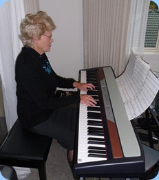 Ngaire McRae playing the Club's Korg SP250 digital piano