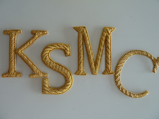 We found these letters at Tinsel Trading. Each of our initials: Kate, Shira, Michael, and Colleen.
