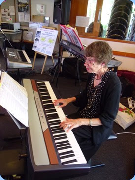 Colleen Kerr playing the Club's Korg SP-250 digital piano. Photo courtesy of Gordon Sutherland