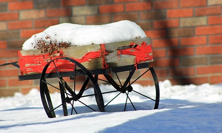 Distressed wagon in snow
