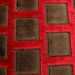 Tkanina obiciowa, trudnopalna. Pluszowa. Motyw geometryczny - krata. Czerwona, brązowa.
