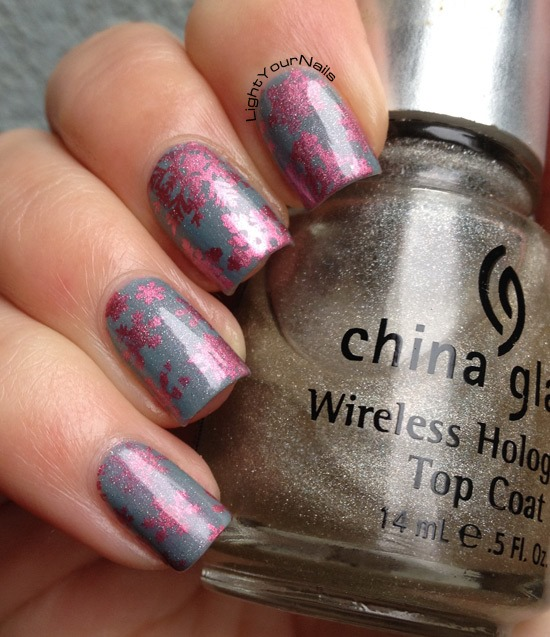Pink snowflakes nailart stamped with QA86 + holographic top coat