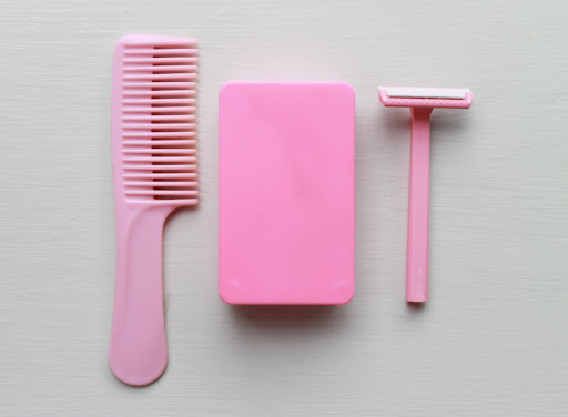 I love these worn pink plastics (comb, travel soap dish, single-blade razor)
