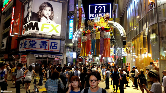 the famous Shibuya fashion district by night in Shibuya, Tokyo, Japan