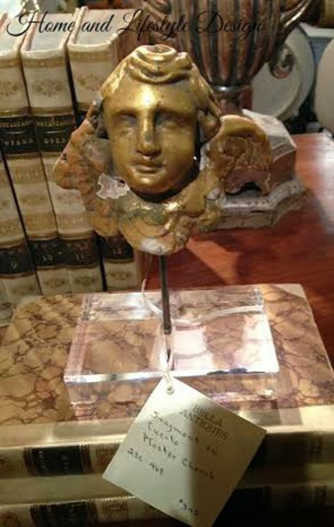 Cherub on lucite stand