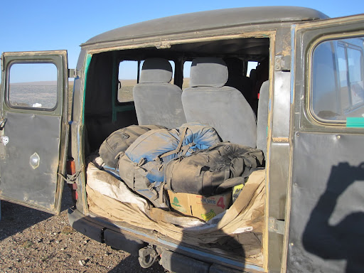 This photo shows how dusty it was inside the van after a day on the steppe. That is my blue backpack in the center.