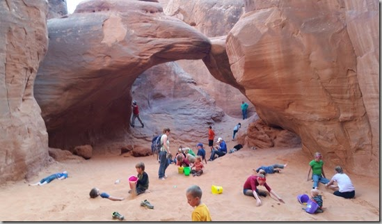 Kids playing at Sand Dune Arch