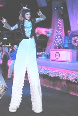 Disney trip parade girl on stilts