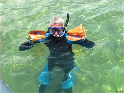 Al with two Conch shells